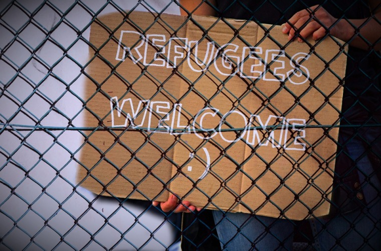 Refugees Fence Shield Welcome Note Announcement